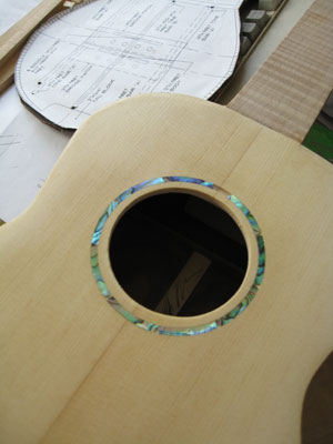 The spruce soundboard on Kahealani's koa uke